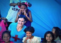 A schoolgirl gives Dr. Farkas bunny ears. CardioStart International provided 13 tents to replace a school destroyed by the earthquakes.
